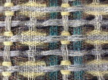 Detail of hand woven fabric in British Wool. Dye made from Goldenrod. Bradford Textile Society Design Competition